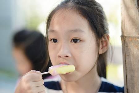 71408683-portrait-of-asian-girl-eating-an-ice-cream.jpg
