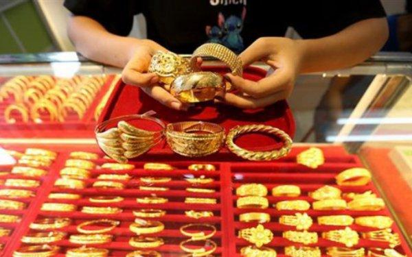 Vàng nhích từng USD giữ thế, thị trường trong nước chiều bán ra đồng loạt tăng lên 55 triệu đồng  - Ảnh 1.