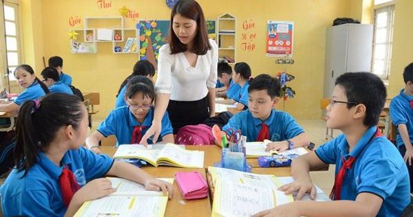 Góc thắc mắc: Tại sao Bộ GD-ĐT không thu học phí tiểu học nhưng phụ huynh vẫn phải đóng tiền học 2 buổi/ngày? - Ảnh 1.