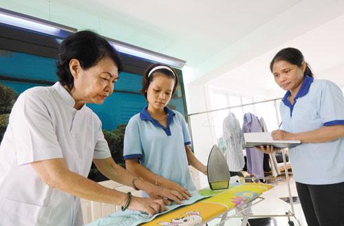 Đề xuất sửa đổi các chính sách BHXH tự nguyện cho hấp dẫn hơn với lao động nữ di cư - Ảnh 1.