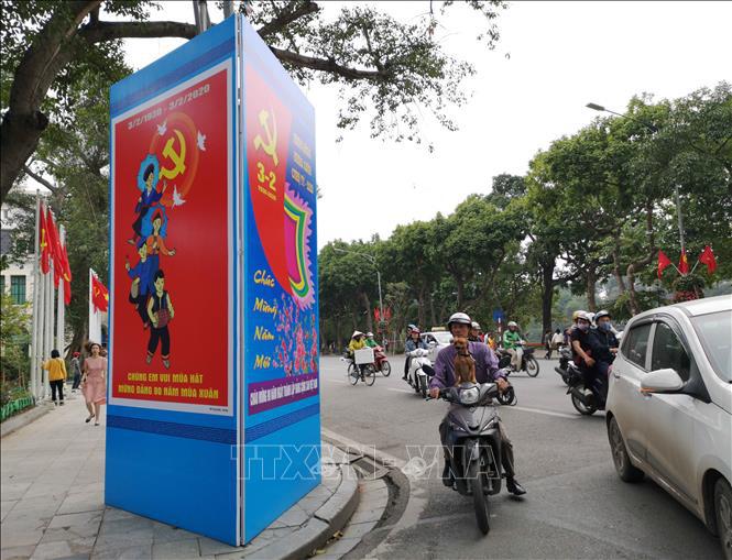 Hà Nội rực rỡ cờ hoa mừng Đảng, mừng Xuân Canh Tý - Ảnh 5.