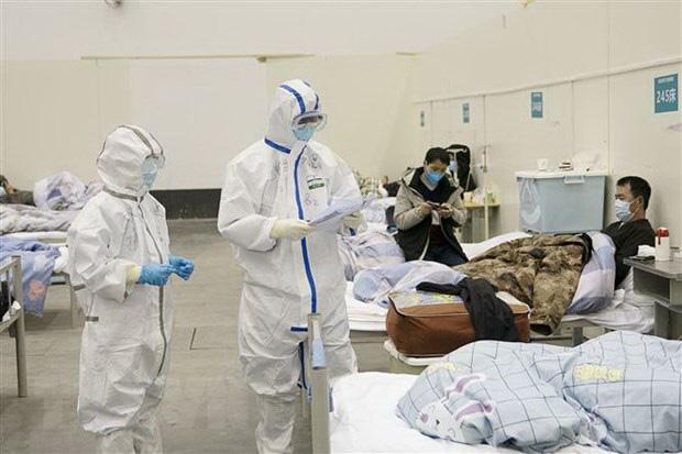 Nữ y tá ở Vũ Hán nhiễm virus corona: Chỉ 1 ngày sau khi khỏi bệnh lại bắt tay vào việc cứu người - Ảnh 1.
