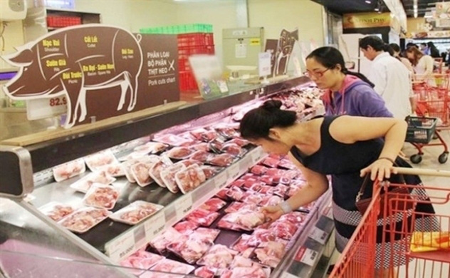 Các doanh nghiệp lớn cam kết giảm giá bán thịt lợn - Ảnh 1.