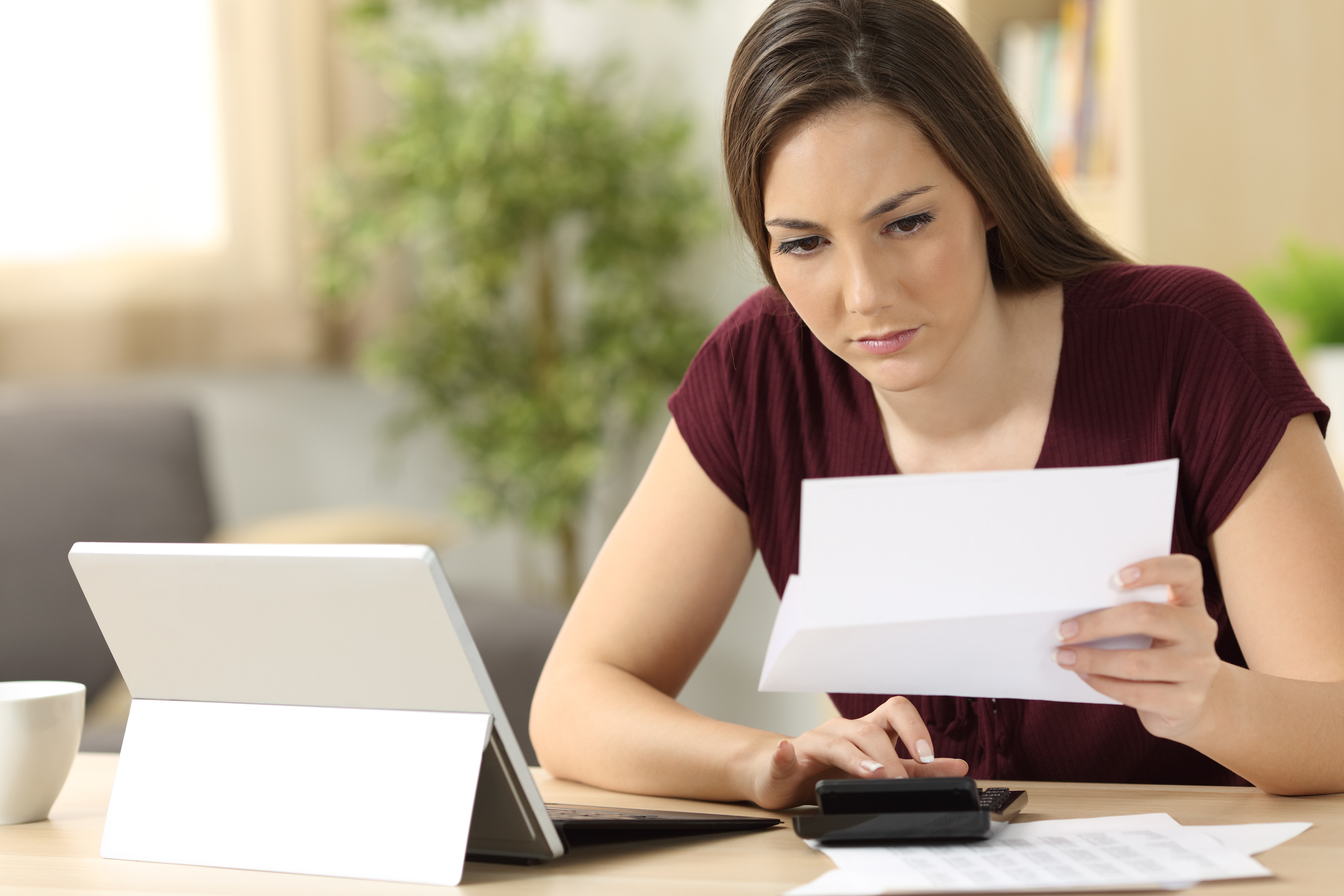 woman-looking-at-document_gettyimages-833135726.jpg