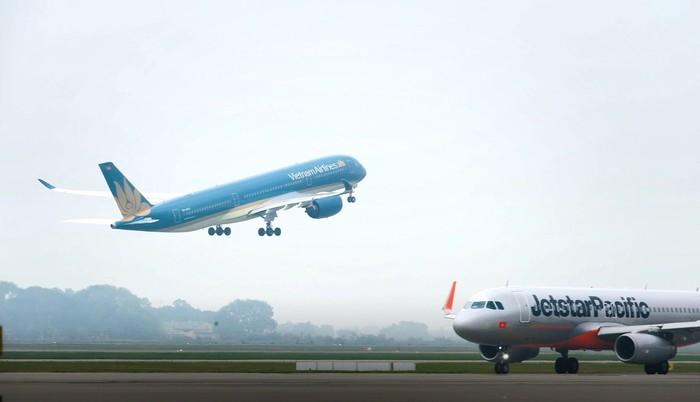 Hàng không tiếp tục đua nhau tung vé từ 0 đồng đến 49.000 đồng/chặng - Ảnh 1.