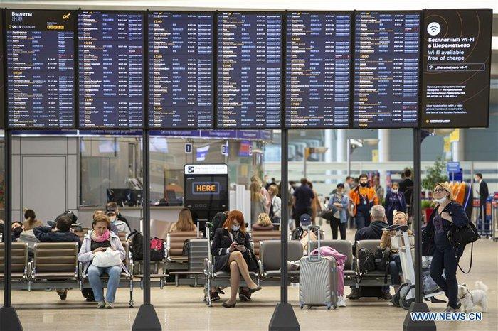 Nga mở lại một phần các chuyến bay quốc tế - Ảnh 4.