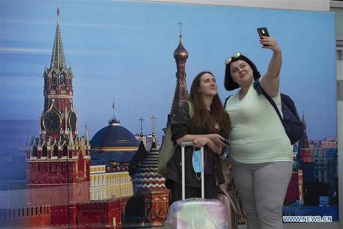 Nga mở lại một phần các chuyến bay quốc tế - Ảnh 5.