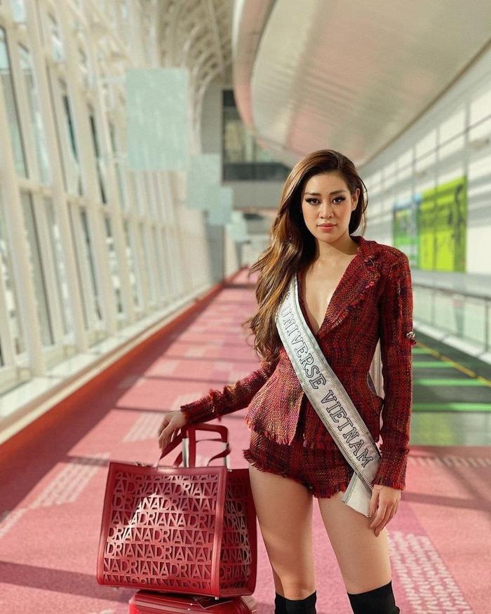 Khánh Vân liên tục thay trang phục trên đường bay đến Mỹ thi Hoa hậu Hoàn vũ - Ảnh 6.