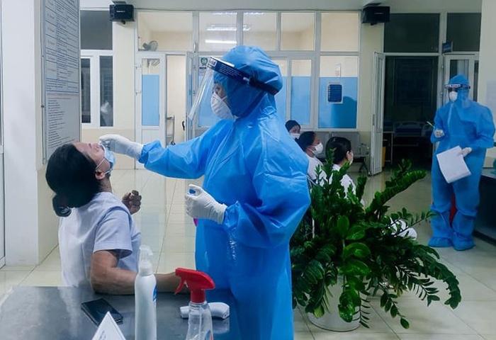 Nghệ An: Phát hiện ca mắc COVID-19 đầu tiên ở TP Vinh - Ảnh 1.