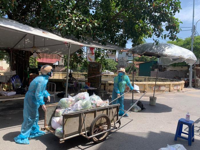 Cửa hàng 0 đồng và những người phụ nữ kéo xe thồ phát lương thực - Ảnh 3.