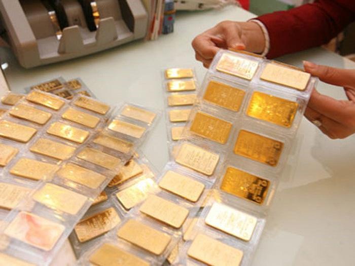 Giá vàng tặng tới gần 1 triệu đồng/lượng trong phiên giao dịch đầu xuân - Ảnh 1.