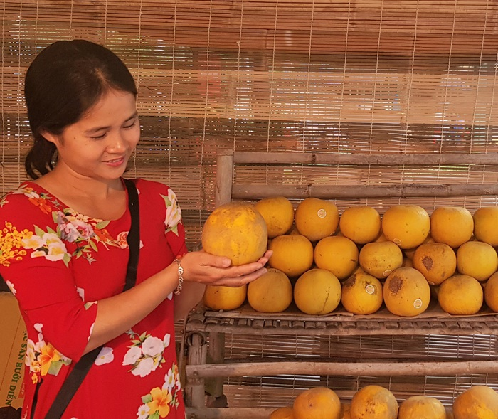 Rộn ràng phiên chợ Tết xưa tại Bảo tàng Phụ nữ Việt Nam - Ảnh 2.