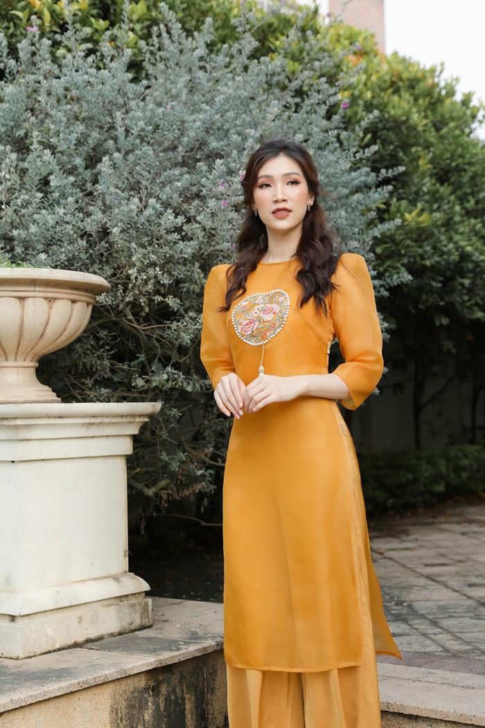 Hoa hậu Phí Thùy Linh đẹp nền nã với áo Tết  - Ảnh 7.