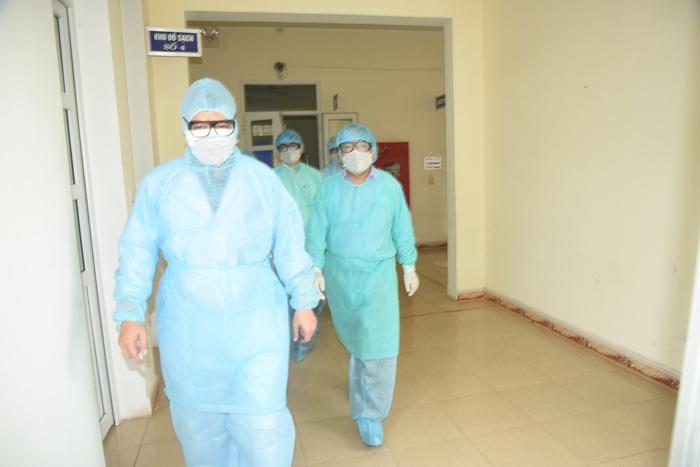 Cách ly người phụ nữ từ Trung Quốc trở về để chờ kết quả xét nghiệm nCoV - Ảnh 1.