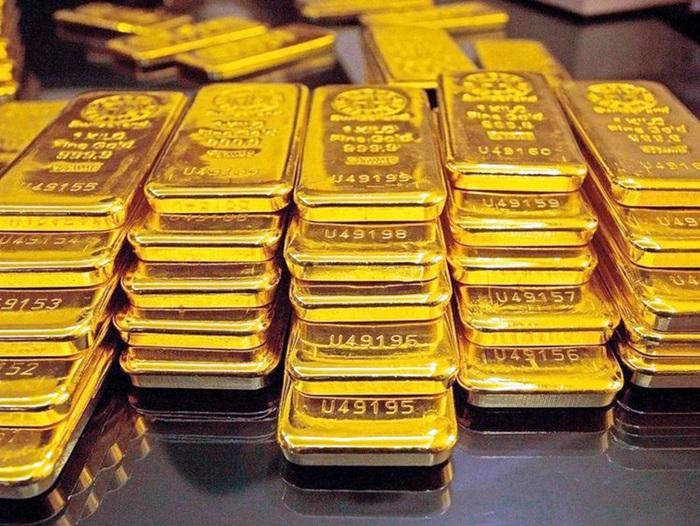 Giá vàng tăng gần 1% trong tuần qua do nhu cầu ''trú ẩn an toàn'' - Ảnh 1.