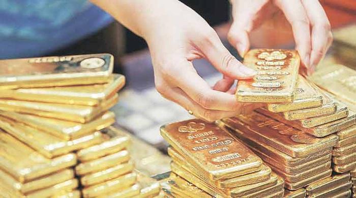 Giá vàng thế giới biến động chưa từng có, vàng trong nước tăng trở lại sau 2 tuần giảm giá - Ảnh 1.