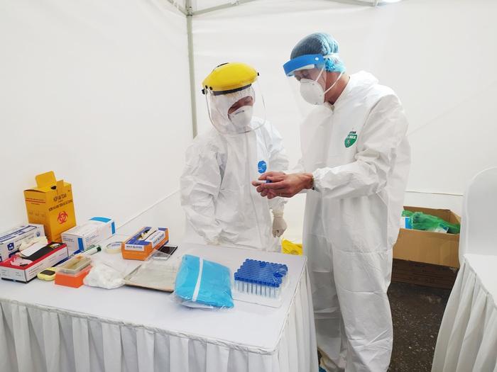 3 mẫu nghi nhiễm Covid-19 qua test nhanh ở Hà Nội có kết quả âm tính - Ảnh 1.