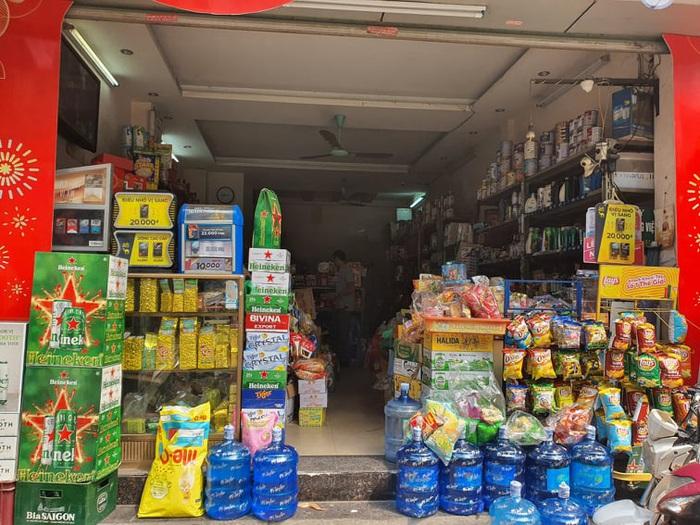 Chợ, siêu thị đầy ắp hàng hóa, thiếu bóng người mua - Ảnh 7.