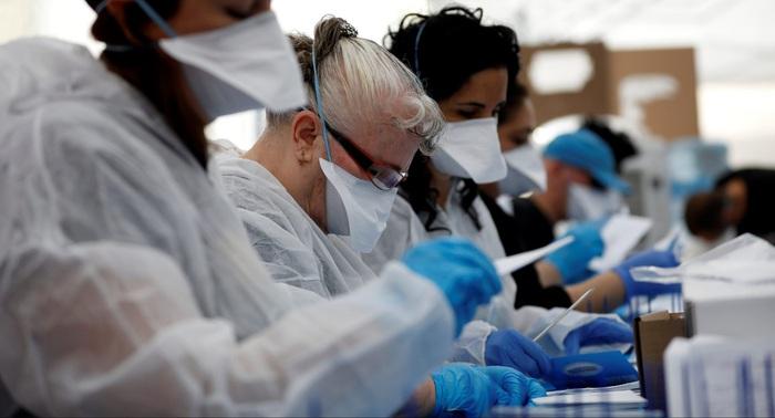 60.000 người Israel tình nguyện tham gia nghiên cứu về Covid-19 - Ảnh 1.