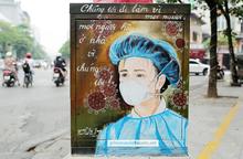 Cận cảnh những bức tranh cổ động y, bác sĩ chống dịch Covid-19 trên bốt điện ở Hà Nội