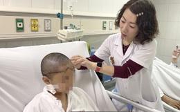 Tóc cuốn vào bánh xe, bé 8 tuổi bị lột toàn bộ da đầu
