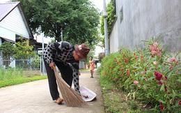Tự nguyện trồng hoa, dọn đường góp phần xây dựng nông thôn mới
