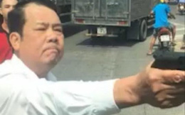 Bắt khẩn cấp giám đốc dùng súng đe dọa tài xế xe tải