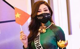 Khánh Vân duyên dáng với áo dài, vẫy cờ Tổ quốc tại Miss Universe