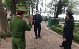 """Hà Nội: Hai người câu cá, một người bán hoa bị xử phạt vì """"ra đường không chính đáng"""""""