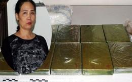 Người phụ nữ xách 12 bánh heroin khai được trả công 100 triệu đồng