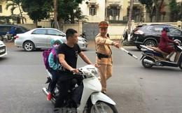 'Nhiều phụ huynh chưa có ý thức đội mũ bảo hiểm cho con khi tham gia giao thông'