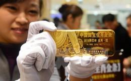"""Giá vàng châu Á rớt """"đáy"""", USD chạm mức cao nhất"""