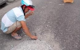 Dân mạng ngợi khen người đàn ông đục khối bê tông trên quốc lộ để tránh tai nạn cho người khác