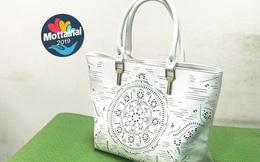Túi xách nữ màu trắng hoa văn dập lỗ bắt mắt giá khởi điểm 55.000 đồng