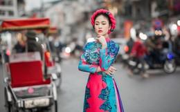 Hoa hậu Tuyết Nga duyên dáng diện áo dài dạo phố