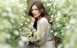 Hoa khôi Miss Photo Vũ Hương Giang mơ màng bên cúc họa mi