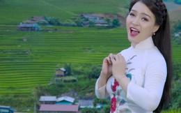 Ca sĩ Đinh Trang mặc áo dài, đi giày cao gót nhảy sạp ở Mù Căng Chải
