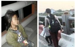 Xót xa hình ảnh bé gái bên thi thể mẹ bị xe máy đâm trên cầu Thanh Trì